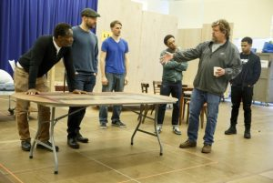 Oskar Eustis (second from right) directs company members in a rehearsal for Julius Caesar